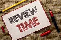 Writing note showing  Review Time. Business photo showcasing Evaluating Survey Reviewing Analysis Checkup Inspection Revision writ. Ten Cardboard Piece the jute Stock Photo