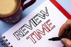 Writing note showing  Review Time. Business photo showcasing Evaluating Survey Reviewing Analysis Checkup Inspection Revision writ. Ten Notebook Book Holding Pen Royalty Free Stock Photo
