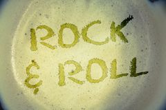 Writing note showing Rock and Roll. Business photos showcasing Musical Genre Type of popular dance music Heavy Beat SoundIdeas me. Writing note showing Rock and royalty free stock image
