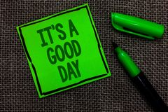 Writing note showing It s is A Good Day. Business photo showcasing Happy time great vibes perfect to enjoy life beautiful Black li. Ned green sticky note with Stock Images