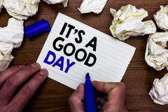 Writing note showing It s is A Good Day. Business photo showcasing Happy time great vibes perfect to enjoy life beautiful Hand hol. Ding marker write words paper Stock Photography