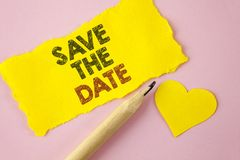 Writing note showing  Save The Date. Business photo showcasing Organizing events well make day special by event organizers written. Tear Yellow paper piece Pink Stock Images