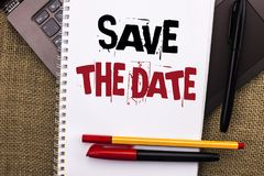 Writing note showing  Save The Date. Business photo showcasing Remember not to schedule anything else that time Appointment writte Royalty Free Stock Image