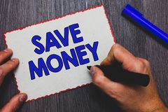 Writing note showing Save Money. Business photo showcasing store some of your cash every month to use them sometime later Man hold. Ing marker paper red borders royalty free stock images