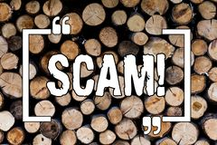 Writing note showing Scam. Business photo showcasing Dishonest Act Fraud Trick People for making money Wooden background vintage. Wood wild message ideas stock image