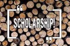 Writing note showing Scholarship. Business photo showcasing Grant or Payment made to support education Academic Study Wooden royalty free stock photography