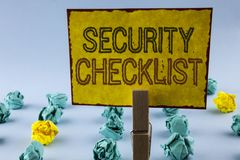 Writing note showing Security Checklist. Business photo showcasing list with authorized names to enter allowing procedures writte royalty free stock images