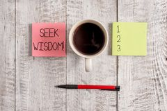 Writing note showing Seek Wisdom. Business photo showcasing ability to think act using knowledge experience stock image