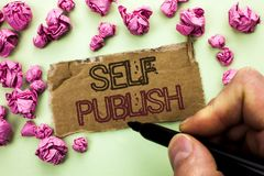 Writing note showing  Self Publish. Business photo showcasing Publication Write Journalism Manuscript Article Facts written by Man. Holding Marker Tear Royalty Free Stock Image