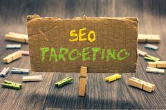 Writing note showing Seo Targeting. Business photo showcasing Specific Keywords for Location Landing Page Top Domain Clothespin ho. Lding paperboard important stock photos