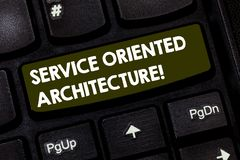 Writing note showing Service Oriented Architecture. Business photo showcasing Central interface A way of organizing. Software Keyboard key Intention to create stock photo