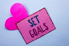 Writing note showing  Set Goals. Business photo showcasing Target Planning Vision Dreams Goal Idea Aim Target Motivation written o. Writing note showing  Set Stock Photography