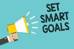 Writing note showing Set Smart Goals. Business photo showcasing Establish achievable objectives Make good business plans Man holdi. Ng megaphone loudspeaker blue stock photos