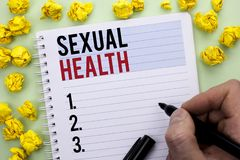 Writing note showing Sexual Health. Business photo showcasing STD prevention Use Protection Healthy Habits Sex Care written By Ma. N Holding Marker Notebook royalty free stock photos