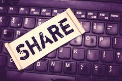 Writing note showing Share. Business photo showcasing part or portion larger amount which is divided among number of. People stock photography