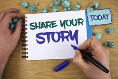 Writing note showing Share Your Story. Business photo showcasing Experience Storytelling Nostalgia Thoughts Memory Personal Text t. Wo words blue white notepad Royalty Free Stock Photos