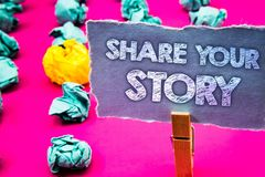 Writing note showing Share Your Story. Business photo showcasing Experience Storytelling Nostalgia Thoughts Memory Personal Words. Torn paper wooden clip pink Stock Image