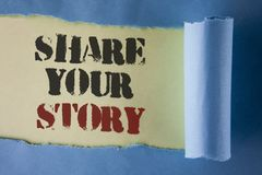Writing note showing Share Your Story. Business photo showcasing Tell personal experiences talk about yourself Storytelling writt. En under Tear Folded paper royalty free stock images