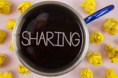 Writing note showing  Sharing. Business photo showcasing To Share Give a portion of something to another Possess in common written. Black Tea in Cup within Stock Photography