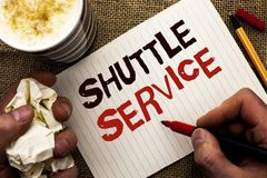 Writing note showing  Shuttle Service. Business photo showcasing Transportation Offer Vacational Travel Tourism Vehicle written by. Man Holding Marker Notebook Stock Image