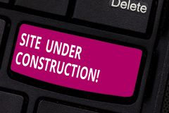 Writing note showing Site Under Construction. Business photo showcasing Implies something is being built for the first. Time Keyboard key Intention to create stock photo