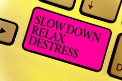 Writing note showing Slow Down Relax Destress. Business photo showcasing calming bring happiness and put you in good mood Keyboard. Pink key Intention computer Stock Photos