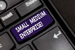 Writing note showing Small Medium Enterprise. Business photo showcasing independent firms which employ fewer employee Keyboard key. Intention to create computer stock images
