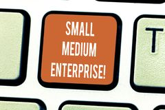 Writing note showing Small Medium Enterprise. Business photo showcasing independent firms which employ fewer employee. Keyboard key Intention to create computer royalty free stock photos
