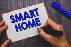 Writing note showing Smart Home. Business photo showcasing automation system control lighting climate entertainment systems Man ho. Lding marker paper red royalty free stock photos