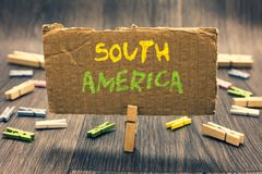 Writing note showing South America. Business photo showcasing Continent in Western Hemisphere Latinos known for Carnivals Clothesp. In holding paperboard stock images