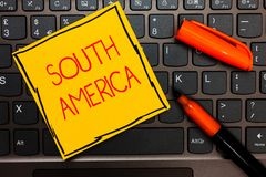 Writing note showing South America. Business photo showcasing Continent in Western Hemisphere Latinos known for Carnivals Yellow p. Aper keyboard Inspiration royalty free stock photo