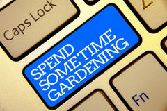 Writing note showing Spend Some Time Gardening. Business photo showcasing Relax planting flowers fruits vegetables Natural Golden. Color computer keyboard blue royalty free stock image
