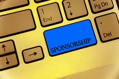 Writing note showing Sponsorship. Business photo showcasing Person or company giving financial material support assistance Keyboar. D brown key yellow laptop Stock Photos