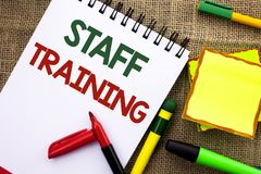 Writing note showing Staff Training. Business photo showcasing Teaching Teamwork new things Employee Education Preparation writte. N Notebook Book the jute stock photos