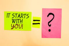 Writing note showing It Starts With You. Business photo showcasing Motivation for starting doing something Have discipline Written. On green sticky note on royalty free stock image