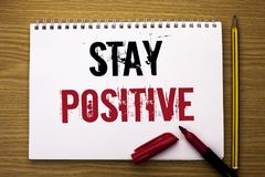 Writing note showing  Stay Positive. Business photo showcasing Be Optimistic Motivated Good Attitude Inspired Hopeful written on N. Writing note showing  Stay Stock Images
