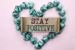 Writing note showing  Stay Positive. Business photo showcasing Be Optimistic Motivated Good Attitude Inspired Hopeful written on C. Writing note showing  Stay Stock Photography