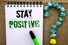 Writing note showing  Stay Positive. Business photo showcasing Be Optimistic Motivated Good Attitude Inspired Hopeful written on N. Writing note showing  Stay Stock Image