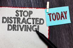 Writing note showing Stop Distracted Driving. Business photo showcasing asking to be careful behind wheel drive slowly White page. Red borders marker clothespin royalty free stock images