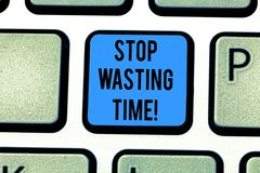 Writing note showing Stop Wasting Time. Business photo showcasing doing something that unnecessary does not produce. Benefit Keyboard key Intention to create royalty free stock photos