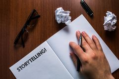 Writing note showing Storytelling. Business photo showcasing activity writing stories for publishing them to public Man. Writing note showing Storytelling stock image
