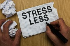 Writing note showing Stress Less. Business photo showcasing Stay away from problems Go out Unwind Meditate Indulge Oneself Man hol. Ding marker notebook paper stock image