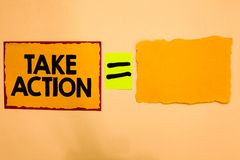 Writing note showing Take Action. Business photo showcasing advices someone to do something or reaction right now Orange paper not. Es reminders equal sign stock image