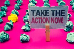 Writing note showing Take The Action Now Motivational Call. Business photo showcasing Act Start Promptly Immediate Instantly Emer. Ald paper balls yellow lump royalty free stock photos