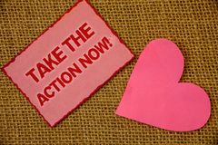 Writing note showing Take The Action Now Motivational Call. Business photo showcasing Act Start Promptly Immediate Instantly Lave. Nder pink page with red border stock images