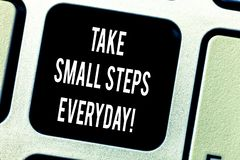 Writing note showing Take Small Steps Everyday. Business photo showcasing Step by step you can reach all your goals. Keyboard key Intention to create computer royalty free stock photo