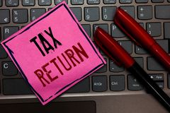 Writing note showing Tax Return. Business photo showcasing which taxpayer makes annual statement of income circumstances Pink pape. R keyboard Inspiration stock images