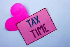 Writing note showing  Tax Time. Business photo showcasing Taxation Deadline Finance Pay Accounting Payment Income Revenue written. Pink Sticky Note Paper the Stock Photos