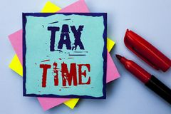 Writing note showing Tax Time. Business photo showcasing Taxation Deadline Finance Pay Accounting Payment Income Revenue written. Sticky Note Paper the Plain stock image