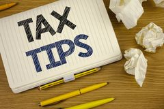 Writing note showing Tax Tips. Business photo showcasing Help Ideas for taxation Increasing Earnings Reduction on expenses Concept. Writing note showing  Tax Stock Images